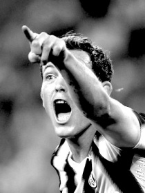 Juventus' Lichtsteiner gestures during the match against AC Milan in their Italian Serie A soccer match in Turin